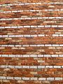 Red brick wall with white stripes.jpg