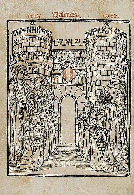 Title page of the incunable edition of the Regiment de la Cosa Pública (Valencia, Cristòfor Cofman, 1499). Francesc Eiximenis is on the right. He offers his book to the jurats of Valencia. On the left is the guardian angel of the city and kingdom of Valencia. The six Jurats de Valencia are kneeling in front of the Serrans gothic gate of the ancient wall of Valencia.
