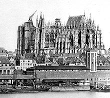 The unfinished Cologne cathedral (1856) with medieval crane on the south tower (Source: Wikimedia)