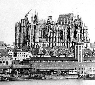 Cologne Cathedral - Unfinished cathedral, 1856 with 15th-century crane on south tower.