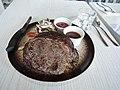 Rib eye beef steak with salad and fries.jpg