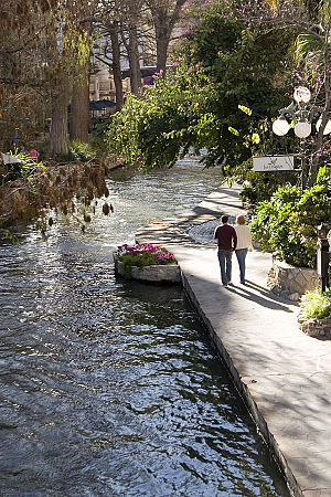 San Antonio River Walk - A couple strolls along the River Walk