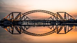 View of Sukkur's iconic British-era Lansdowne Bridge and the modern Ayub Bridge, which both span the Indus River and offer access to the city of Rohri