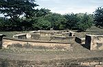 Ruins consisting of foundations of small buildings.