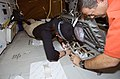 STS-125 Crew Members Work with the LiOH Cannisters on the Middeck (28162882361).jpg