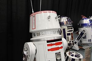 Droid (robot) - SWCA - Replicas of Astromech Droids R5-D4 (left) and R2-D2 (right foreground), from the ''Star Wars'' Celebration in Anaheim, California (April 2015)