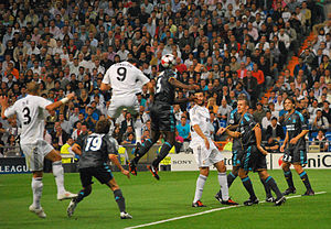 Header (association football) - Cristiano Ronaldo (9, white) heading the ball into the net for Real Madrid against Marseille in the 2009–10 UEFA Champions League.