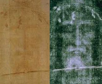 Relics associated with Jesus - A recent photo of the Shroud of Turin face, positive left, negative on the right having been contrast enhanced