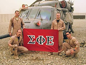 Fraternities and sororities - U.S. Army soldiers, presumably members of Sigma Phi Epsilon, display that fraternity's flag in Iraq in 2009.