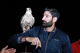 Sohail Tanvir with a native eagle in the UAE.jpg