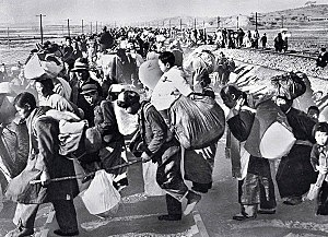 Korean War - Hundreds of thousands of South Koreans fled south in mid-1950 after the North Korean army invaded