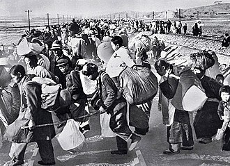Korean War - Hundreds of thousands of South Koreans fled south in mid-1950 after the North Korean army invaded.