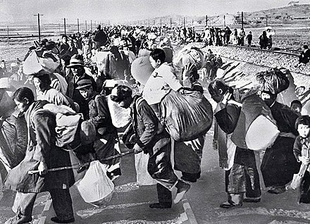 Hundreds of thousands of South Koreans fled south in mid-1950 after the North Korean army invaded. South Korean refugees mid-1950.jpg