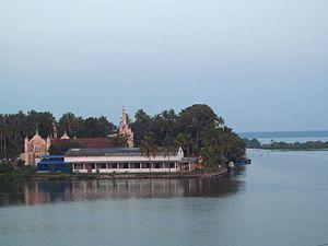 Chavara Thekkumbhagom - St.Joseph Church located southern most part of Chavara Thekkumbhagom Village. This shot from Pallikkodi Dalavapuram Bridge