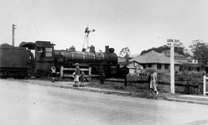 Ferny Grove railway line - Image: State Lib Qld 1 119876 Train passing through the level crossing in Wardell Street, Enoggera, ca. 1950