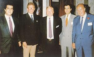John Fredriksen - Fredriksen (centre) and Stelios Haji-Ioannou (far left) at a meeting in 1989.