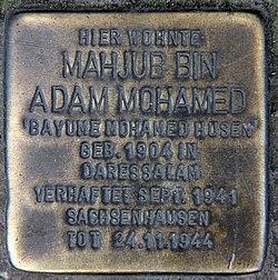Photo of Mahjub (Bayume Mohamed) bin Adam Mohamed (Husen) brass plaque