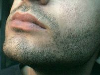 Facial hair of a male that has been shaved