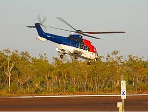 Mungalalu Truscott Airbase - A CHC Helicopters Super Puma helicopter takes off from Truscott Air Base en route to the off shore oil and gas fields in 2007