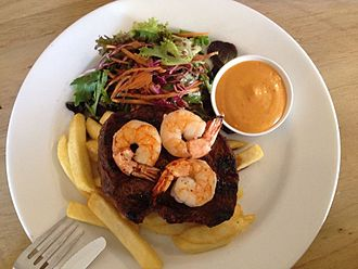 Surf and turf - Steak and three shrimp, served with spicy mayonnaise, side salad and fries