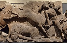 The Bassai sculptures, marble block from the frieze of the Temple of Apollo Epikourios at Bassae (Greece), Lapiths fight Centaurs, about 420-400 BC, British Museum (14073626197).jpg