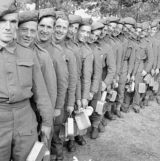 King's Shropshire Light Infantry - Men of the King's Shropshire Light Infantry queue for their rations at a rest camp in Holland, 26 October 1944.