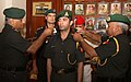 The Chief of Army Staff, Gen. V.K. Singh pipping in the Rank of Hon. Lt. Col. to Shooter Abhinav Bindra, in New Delhi on November 01, 2011.jpg