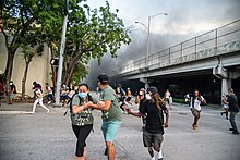 Miami protesters react to police firing chemical irritants on May 30