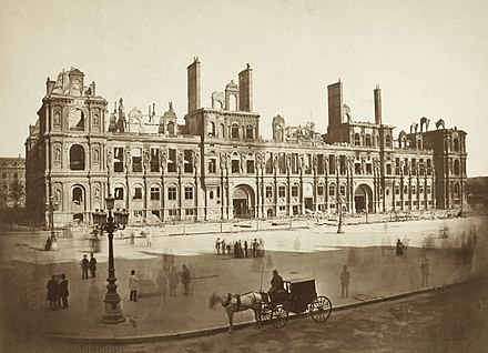 The ruins of the Hotel de Ville of Paris, the headquarters of the Commune, burned by the National Guard on 24 May and later rebuilt The Hotel de Ville after the Commune.jpg