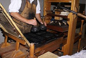 Joseph Royle - Applying the ink to the types