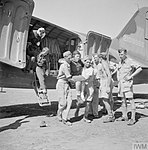 The RAF evacuating wounded partisans from Yugoslavia. A wounded female partisan being carried from one of the transport aircraft on arrival in Italy, 1944.jpg