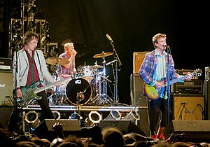 Tommy Stinson - Stinson (left) playing with the Replacements in 2012.
