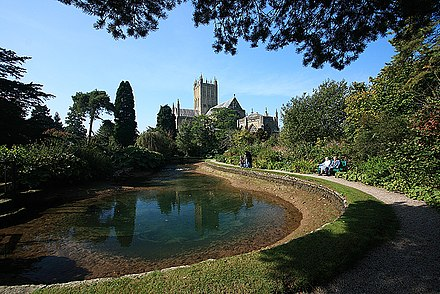 One of the three wells which give the city its name; two are located in the gardens of the Bishop's Palace (as shown) and one in the Market Place. The Wells, Bishop's Palace Gardens - Wells - geograph.org.uk - 986021.jpg