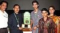 The fourth generation of Patwardhan family (the innovators of 'Shambharik Kharolika') and NFAI Director, Shri Vijay Jadhav with the historic Magic Lantern, at the 40th International Film Festival (IFFI-2009), in Panaji, Goa.jpg