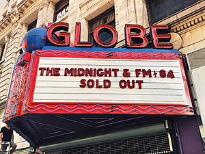 The Midnight (band) - Image: The midnight fm 84 the globe theatre exterior 201711