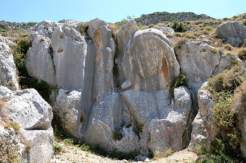 FileThe so-called Charonion a carved stone bust on the mountainside above Antioch it dates from the time of King Antiochus in the Seleucid era 3rd century BC Antioch on the Orontes Antakya Turkey 36194292466jpg