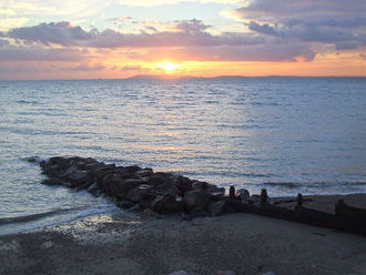 Selsey Bill - Sunset over the Isle of Wight seen from Selsey Bill.