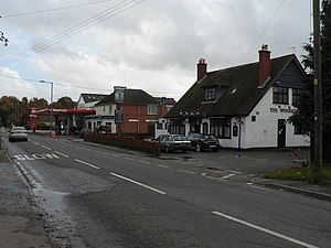Three Legged Cross - Image: Three Legged Cross, The Woodcutters, shop and garage geograph.org.uk 1037803