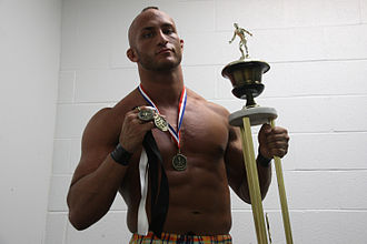 Tommaso Ciampa - Ciampa holding the award for winning the ECWA Super 8 Tournament in 2011
