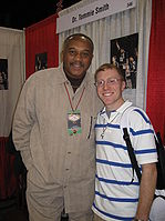 Tommie Smith avec un fan.