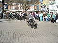 Top-hatted cyclist at The Square - geograph.org.uk - 1251807.jpg