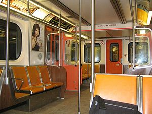 H-series (Toronto subway) - Interior of an H6 subway car with individual vinyl orange covered seats.