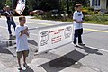 Trevor and Spencer helped carrying a banner (234380564).jpg