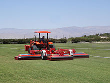 A typical roller mower operating on a sod grass farm