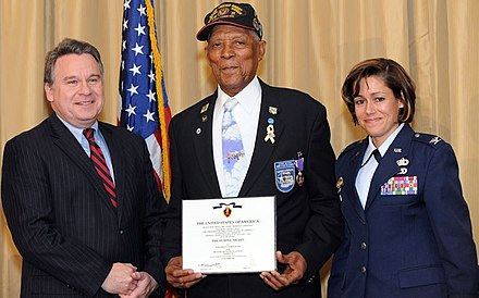 Congressman Christopher Smith presented the Purple Heart Medal to Tuskegee Airman Tech. Sgt. (Ret.) George Watson Sr. with then Col. Gina M. Grosso, Joint Base McGuire-Dix-Lakehurst commander