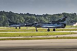 Two F-21 KFIRs taxi on the flight line aboard Marine Corps Air Station Beaufort.jpg