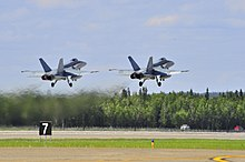 Two No 3 Sqn RAAF FA-18s taking off July 2011.JPG