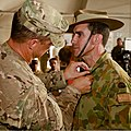 U.S. Army Lt. Col. Anthony Noll, left, the deputy commander of Combined Team Uruzgan, pins a Bronze Medal on the uniform of Australian Army Col. Simon Stuart during a transfer of authority ceremony for Combined 130807-O-MD709-167-AU.jpg