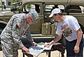 U.S. Army Maj. Gen. Leslie Carroll, left, the chief of staff of U.S. Army Forces Command, and Kurt Haushalter, with the Military Vehicle Preservation Association, look through military magazines about old Army 130613-A-LZ307-003.jpg