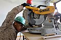 U.S. Marine Corps Pfc. Ismael Moctezumadelalanza, a combat engineer with the 9th Engineer Support Battalion, 3rd Marine Logistics Group, uses a saw during a renovation project at Erdmiin Oyun High School in 130722-M-DR618-113.jpg